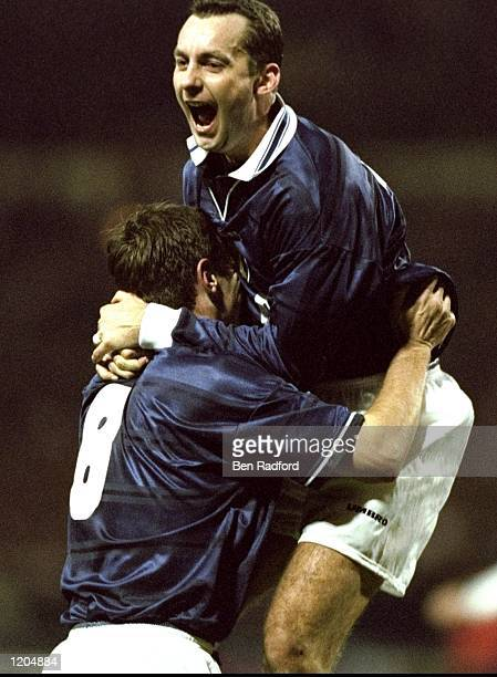 Don Hutchison of Scotland celebrates his goal with team mate Craig Burley during the England v Scotland Euro 2000 playoff second leg match at Wembley...