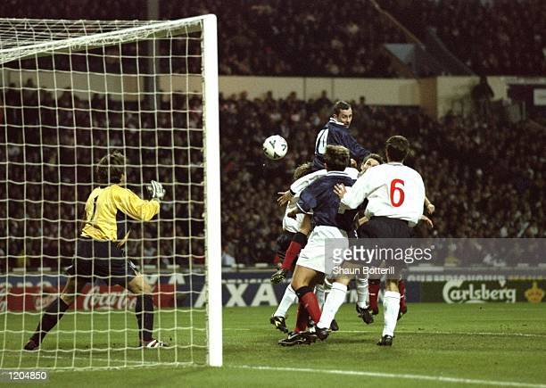 Don Hutchison rises above the England defence to score for Scotland during the Euro 2000 playoff second leg match at Wembley Stadium London Scotland...