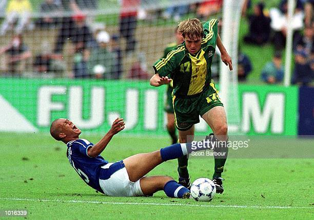 Dylan MacAllister of Australia evades the challenge of Eduardo of Brazil during the FIFA Under 17 World Cup soccer final at the North Harbour Stadium...