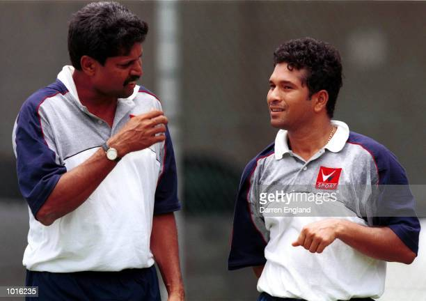 Indian Coach Kapil Dev talks to Indian Captain Sachin Tendulkar during the Indian training session prior to the four day test match against the...