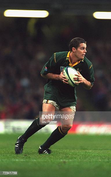 Johan Erasmus of South Africa runs with the ball during the Rugby Union World Cup 1999 match against New Zealand played at the Millennium Stadium in...