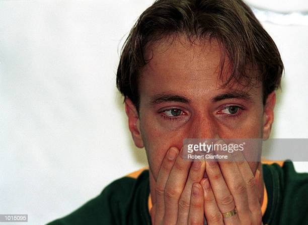 Mark Bosnich of Australia reflects on the Socceroos loss to Brazil at the post match press conference after the friendly soccer game played at...