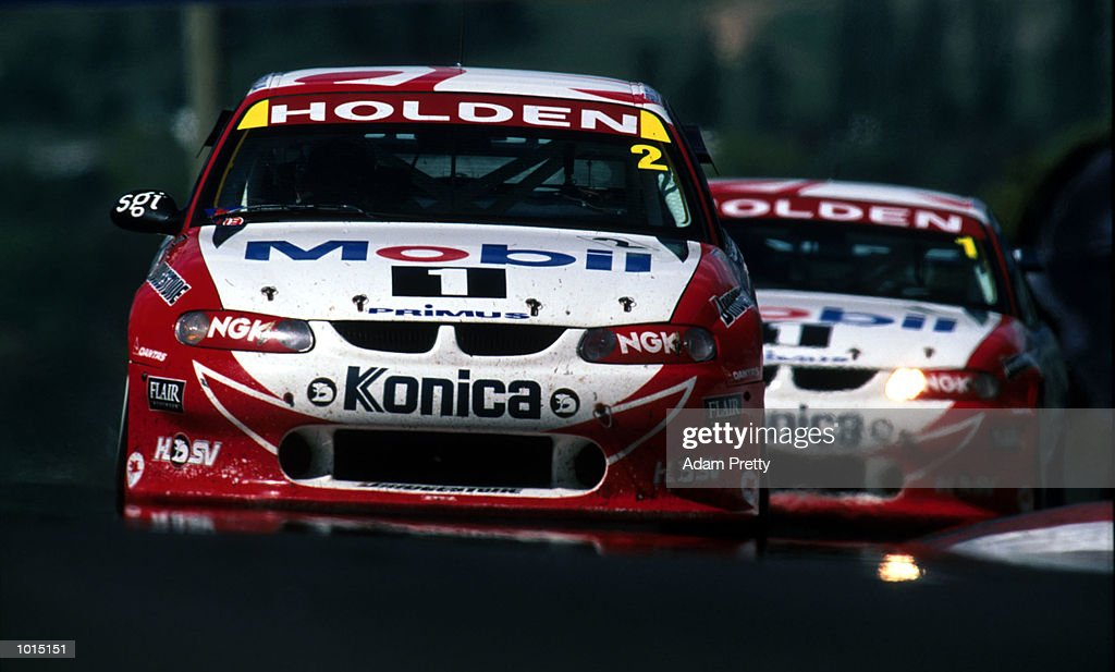 Mark Skaife and Paul Morris of the Mobil Holden Racing Team lead Craig Lowndes and Cameron McConville also of the Mobil Holden Racing Team during the FAI 1000 at Mount Panorama, Bathurst, New South Wales, Australia. Mandatory Credit: Adam Pretty/ALLSPORT