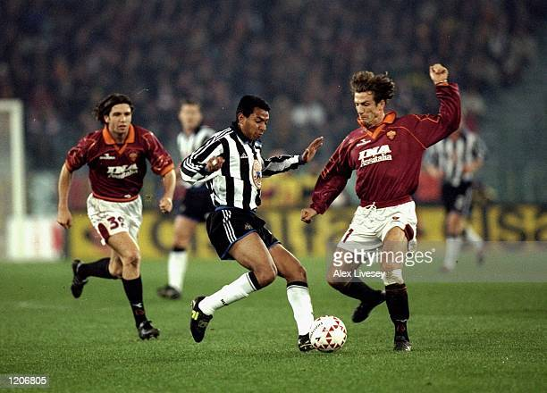 Nolberto Solano of Newcastle United is tackled by Eusebio Di Francesco of AS Roma during the UEFA Cup Third Round First Leg match at the Stadio...