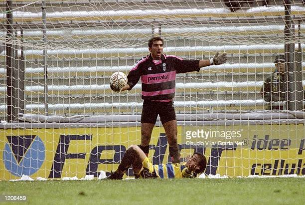 Parma keeper Gianluigi Buffon tidies up as Fabio Cannavaro goes down against Cagliari during the Serie A match at the Stadio Tardini in Parma Italy...
