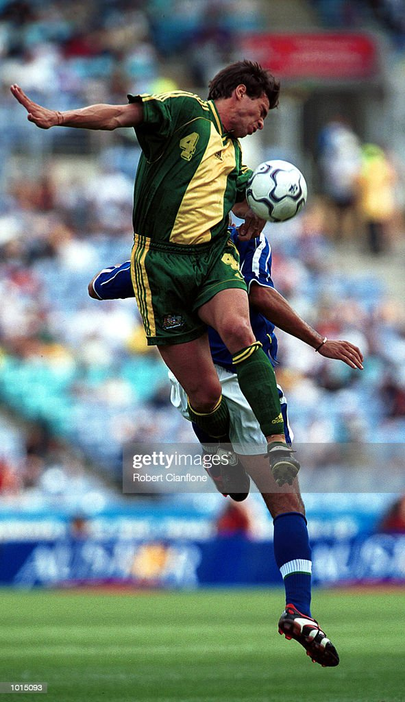 Paul Okon of Australia gets over the top of his Brazilian opponent during the friendly soccer game played at Stadium Australia, Homebush, Sydney, Australia. Brazil won the game two goals to nil. Mandatory Credit: Robert Cianflone/ALLSPORT