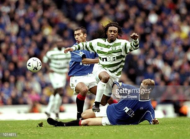 Regi Blinker of Celtic is foiled by Giovanni van Bronckhorst and Craig Moore of Rangers in the Scottish Premier League match at Ibrox in Glasgow...