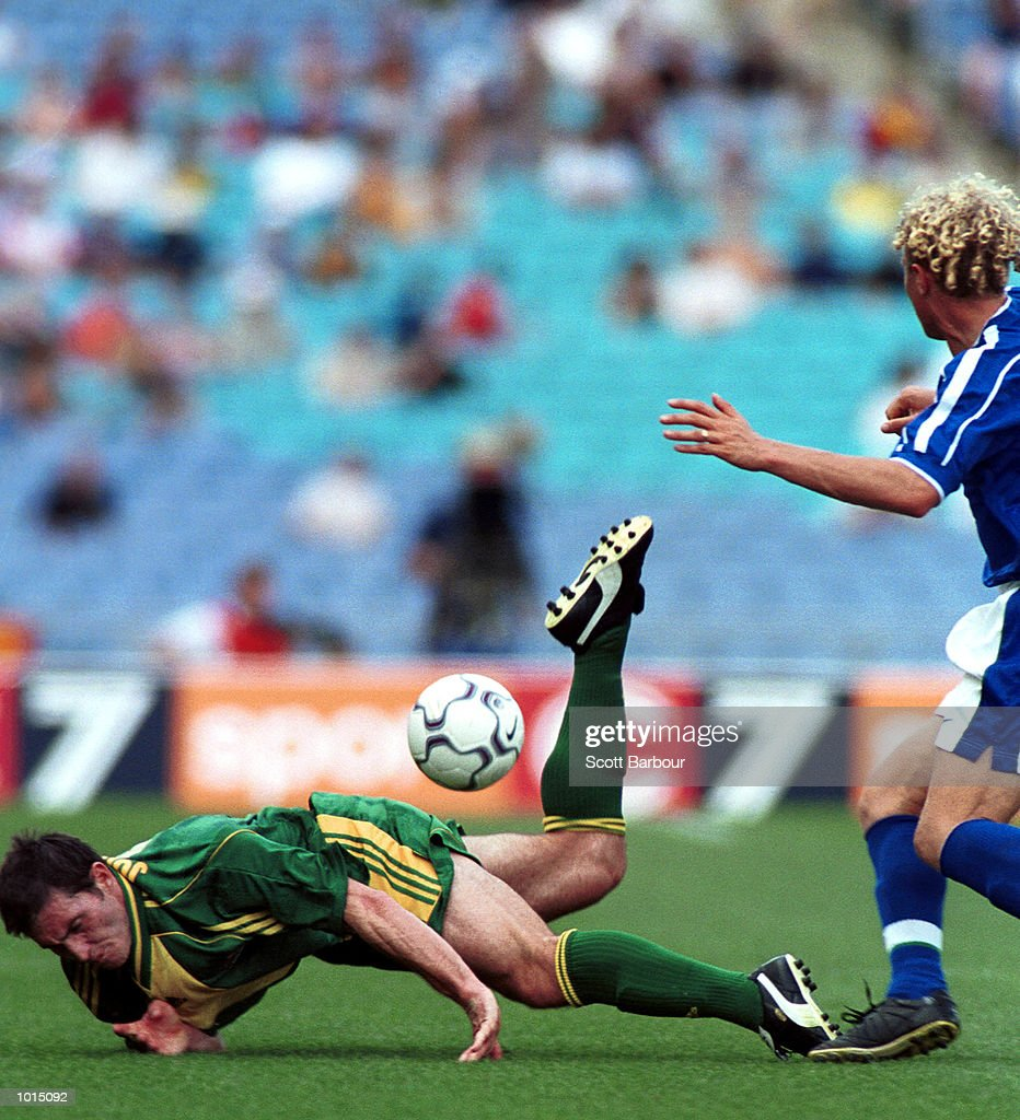 Richard Johnson of Australia is brought down by Mozart of Brazil during the friendly soccer game played at Stadium Australia, Homebush, Sydney, Australia. Brazil won the game two goals to nil. Mandatory Credit: Scott Barbour/ALLSPORT