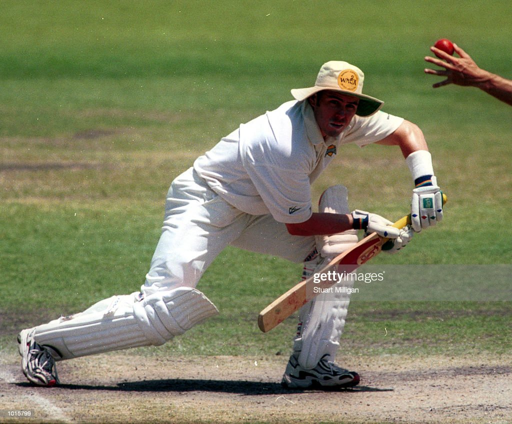 Ryan Campbell, batsman for Western Australia, drives the ball into the ground and is fielded by a close in fieldsman for South Australia, during day two of the Pura Milk Cup Match played between South Australia and Western Australia at theAdelaide Oval. Mandatory Credit: Stuart Milligan/ALLSPORT