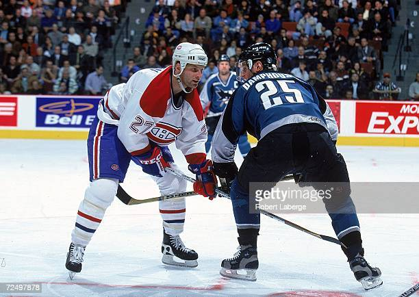 Shayne Corson of the Montreal Canadiens faces off with Vincent Damphousse of the San Jose Sharks at the Molson Centre in Montreal Quebec Canada The...