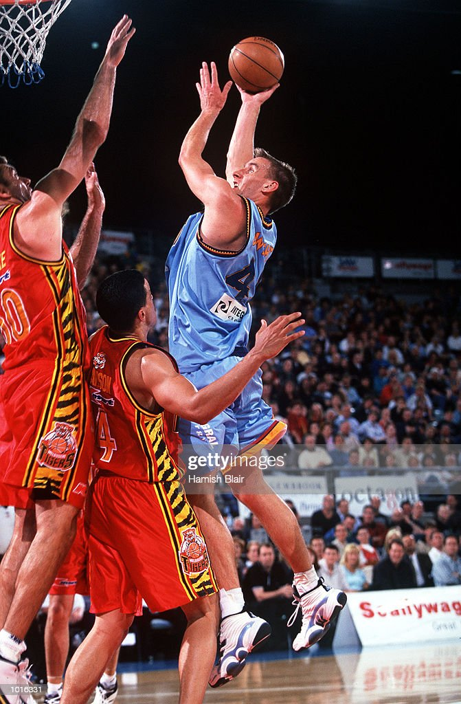 Simon Dwight of West Sydney shoots over Mark Bradtke of Melbourne, during the game between Melbourne and West Sydney at Melbourne Park, Melbourne, Australia. Melbourne defeated West Sydney 103 - 97. Mandatory Credit: Hamish Blair/ALLSPORT