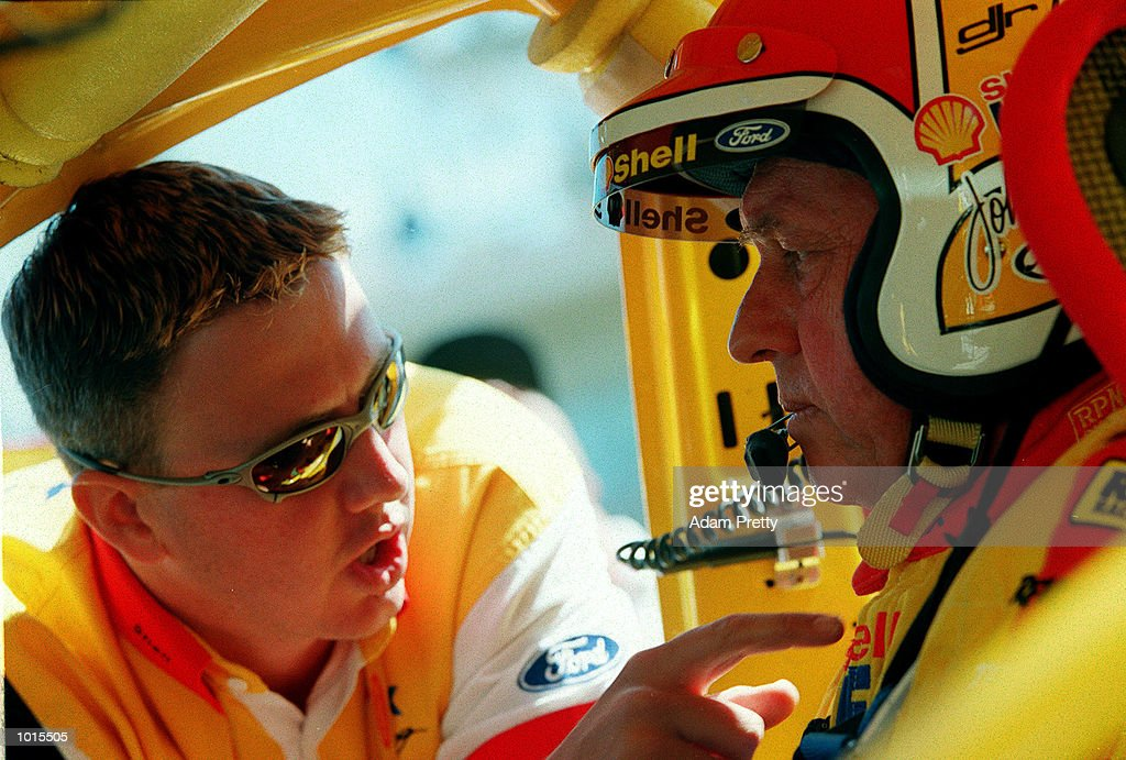Son Steven Johnson and Dick Johnson from the Shell Helix racing team talk tactics in the Ford during the practice rounds of the Bathurst FAI 1000 at Mount Panorama,Bathurst Australia. Mandatory Credit: Adam Pretty/ALLSPORT