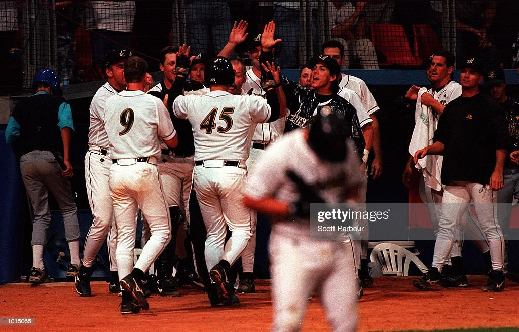 The Australia baseball team congratulate # 45 Michael Moyle after he scored a home run during the 2-0 victory over Japan during the IBA Intercontinental Baseball Cup semi finals at the Baseball Stadium, Olympic Park, Homebush, Sydney, Australia. Mandatory Credit: Scott Barbour/ALLSPORT