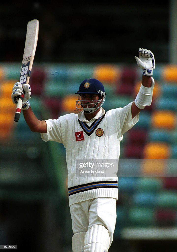 Vangipuapu Venkata Sai Laxman of India celebrates scoring a century against Queensland at the Gabba cricket ground in Brisbane. Mandatory Credit: Darren England/ALLSPORT
