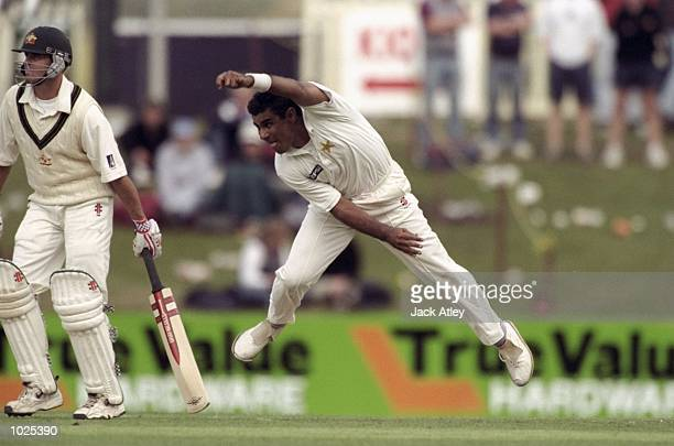 Waqar Younis of Pakistan throws himseld into a delivery during the second Test match against Australia at the Bellerive Oval in Hobart Australia...
