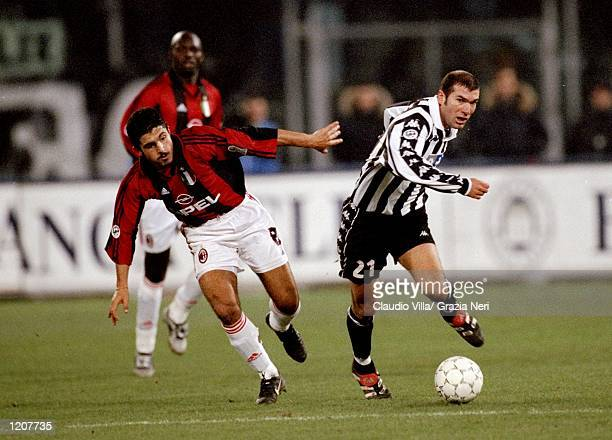 Zinedine Zidane of Juventus takes on Gennaro Gattuso of AC Milan during the Italian Serie match at the Stadio Delle Alpi in Turin Italy Mandatory...