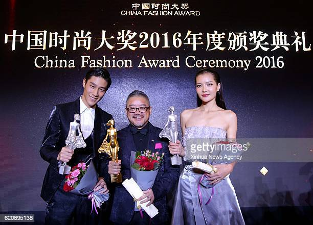 Liu Yong winner of the China Fashion Designer Top Award and Zeng Lingling and Shi Qifan winners of the Best Fashion Model acknowledge the audience...