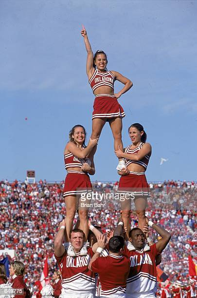 A view of the Oklahoma Sooners cheerleaders as they form a pyramid taken during the game against the Texas Tech Red Raiders at the Oklahoma Memorail...