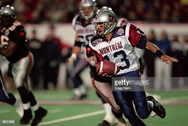 Anthony Calvillo of the Montreal Alouettes runs with the ball during the Grey Cup 2000 game against the British Columbia Lions at the McMahon Stadium...