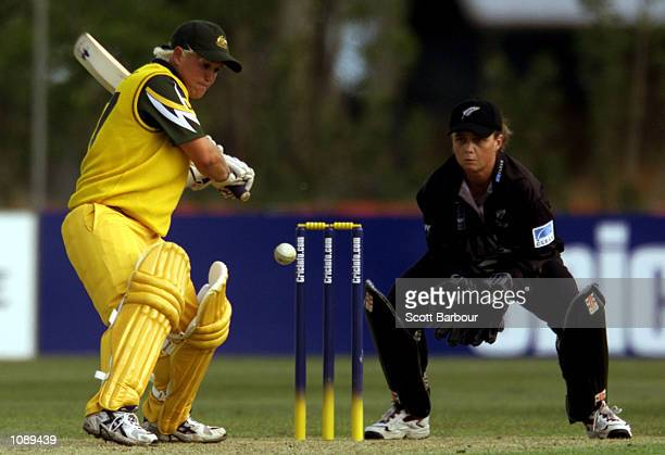 Cherie Bambury of Australia in action as New Zealand wicketkeeper Rebecca Rolls looks on during the New Zealand v Australia match in the 2000...