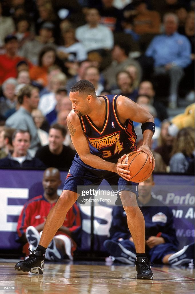 Chris Mills of the Golden State Warriors moves with the ball during the game against the Denver Nuggets at the Pepsi Center in Denver Colorado The...