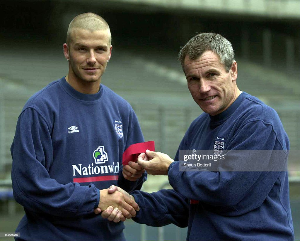England caretaker/manager David Taylor gives David Beckham the captain's armband prior to the match against Italy at the Del Alpi StadiumTurin...