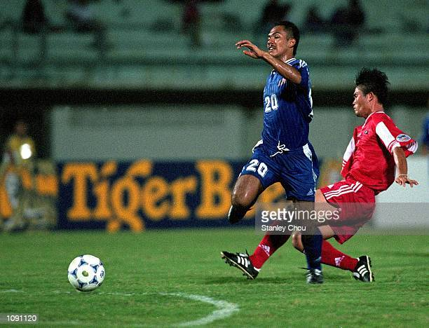 Hairuddin Omar of Malaysia battles Chanthavong Khamsay of Laos during the Tiger Cup match between Malaysia and Laos at Tinsulanon Stadium in Bangkok...