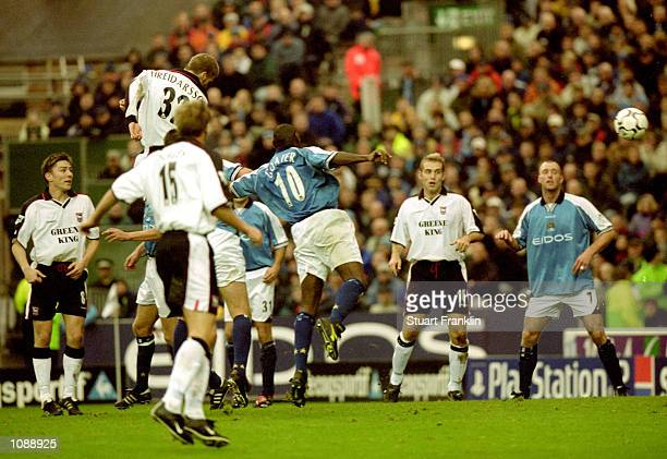 Hermann Hreidarsson of Ipswich Town rises above Shaun Goater of Manchester City to score during the FA Carling Premiership match at Maine Road in...