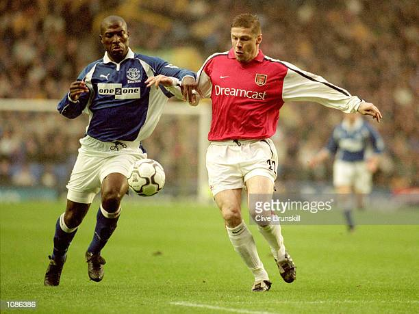 Kevin Campbell of Everton battles with Oleg Luzhny of Arsenal during the FA Carling Premier League match played at Goodison Park in Liverpool England...