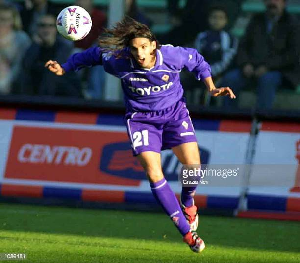 Nuno Gomes of Fiorentina scores a headed goal during the Serie A 7th round league match between Fiorentina and Vicenza played at the Artmio Franchi...