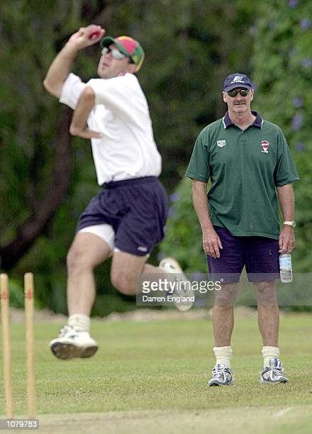 Ricky Ponting of the Australian Cricket team in action while Australian bowling great Dennis Lillee looks on during a training session at Buderim on...