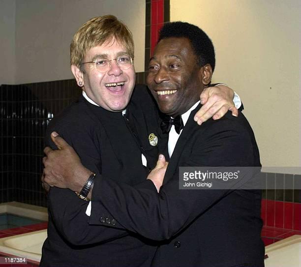 Sir Elton John and Pele share a joke in the players dressing room during The AXA Final Ball at Wembley Stadium London Mandatory Credit John...