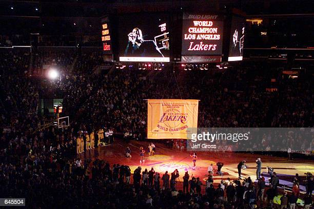 The Los Angeles Lakers'' Championship banner is lowered from the Jumbo Tron prior to their game against the Utah Jazz at Staples Center in Los...