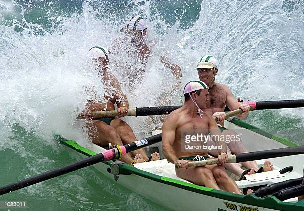 The North Burleigh Surf Lifesaving club's Surf Boat crew crashes thru the waves during the heats of the mens open Surf Boat race during round two of...