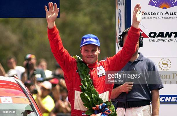 Tommi Makinen of Finland and the Marlboro Mitsubishi Ralliart team celebrates victory on the final day of the Telstra Rally Australia which is part...