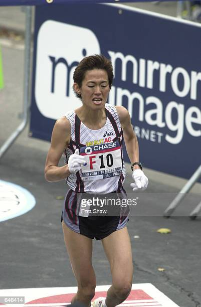 Yuko Arimori of Japan crosses the finish line in 23112 to take 10th place in the New York City Marathon Mandatory Credit Ezra Shaw/ALLSPORT