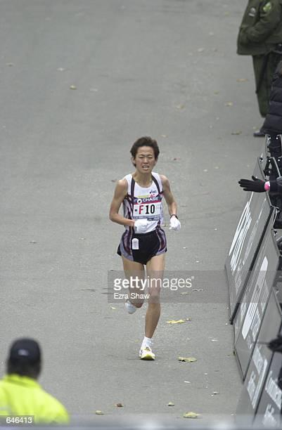 Yuko Arimori of Japan finishes the New York City Marathon in 23112 to take 10th place Mandatory Credit Ezra Shaw/ALLSPORT