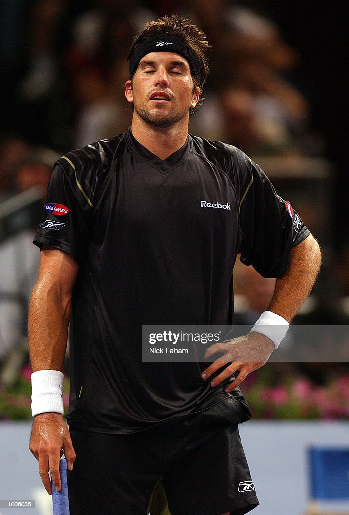 A dejected Patrick Rafter of Australia during his loss to Lleyton Hewitt of Australia during the Tennis Masters Cup held at the Sydney Superdome, Sydney, Australia. DIGITAL IMAGE Mandatory Credit: Nick Laham/ALLSPORT