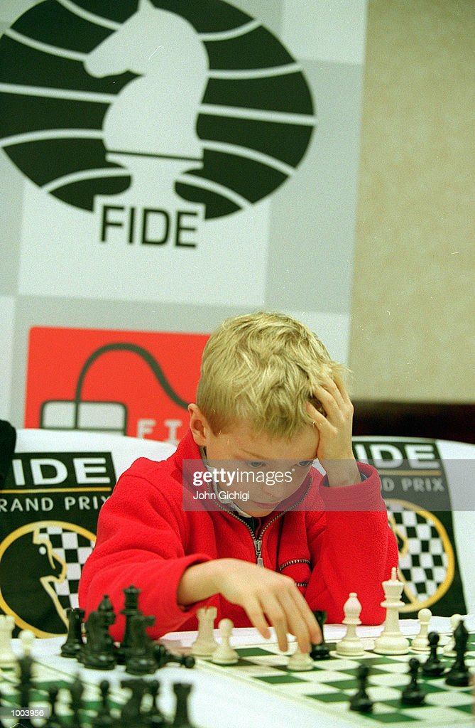 A young boy ponders his next move during an exhibition match against Michael Adams of England, World Speed Chess Champion and number four ranked player at the FIDE World Chess Championships Press Conference held at Chelsea Football Club, London. Mandatory Credit: John Gichigi/ALLSPORT