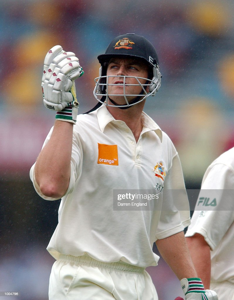 Adam Gilchrist of Australia looks to the heavens as he leaves the field due to a rain delay during day two of the first Cricket test between Australia and New Zealand played at the Gabba in Brisbane, Australia. DIGITAL IMAGE. Mandatory Credit: Darren England/ALLSPORT