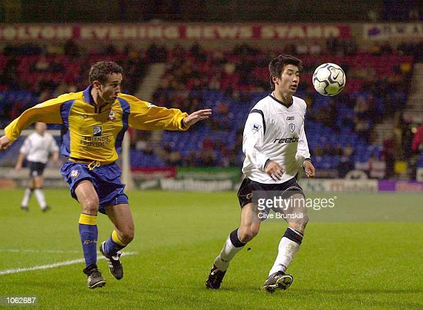 Akinori Nishizawa of Bolton clashes with Matt Oakley of Southampton during the Bolton Wanderers v Southampton Wothington Cup Fourth round match at...