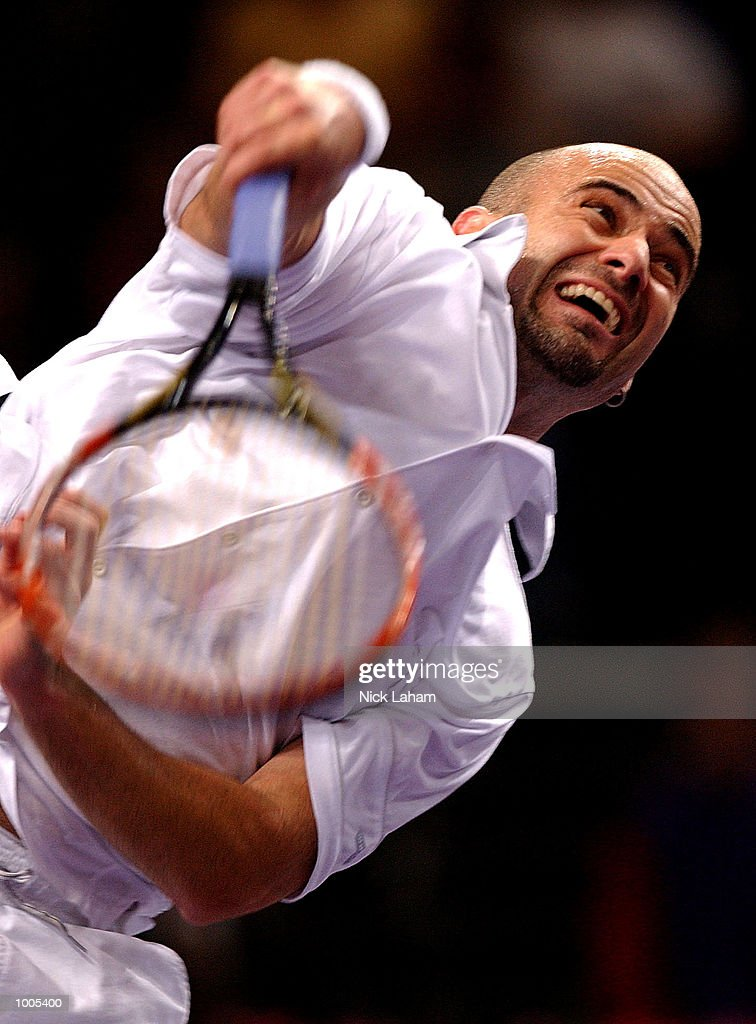Andre Agassi of the United States in action against Patrick Rafter of Australia during the Tennis Masters Cup held at the Sydney Superdome, Sydney, Australia. DIGITAL IMAGE Mandatory Credit: Nick Laham/ALLSPORT