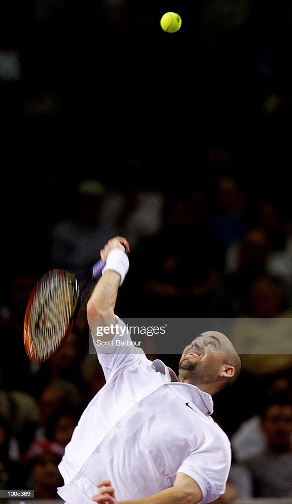 Andre Agassi of USA in action during his match against Patrick Rafter of Australia during day one of the Tennis Masters Cup held at the Sydney Superdome in Sydney, Australia. DIGITAL IMAGE. Mandatory Credit: Scott Barbour/ALLSPORT