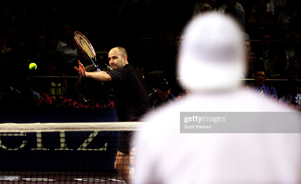 Andre Agassi of USA returns during his loss to Sebastien Grojean of France during day four of the Tennis Masters Cup held at the Sydney Superdome in Sydney, Australia. DIGITAL IMAGE. Mandatory Credit: Scott Barbour/ALLSPORT