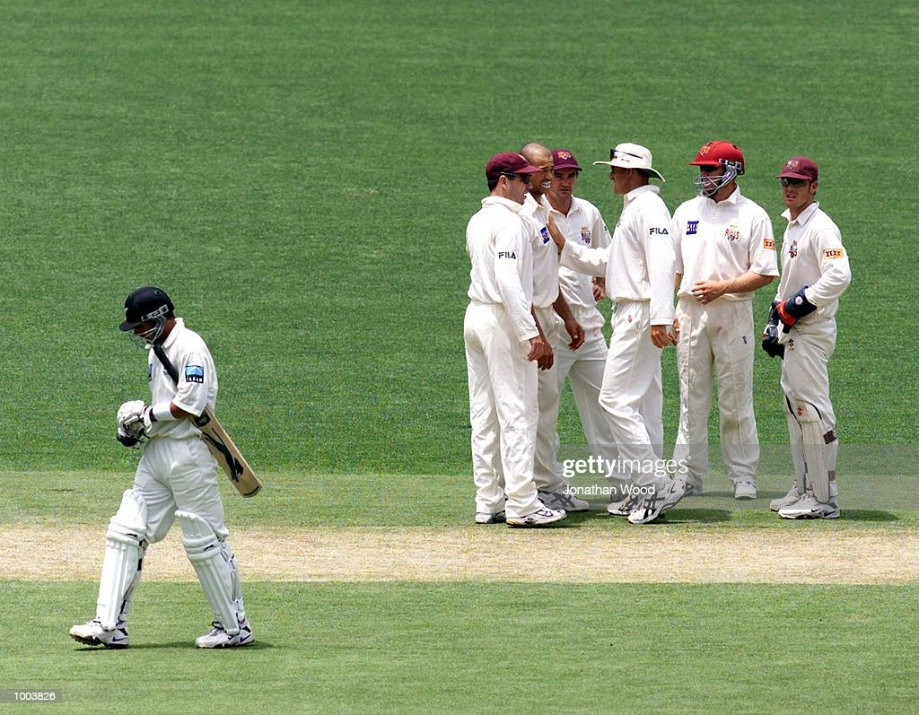 Andrew Symonds of Queensland celebrates the wicket of Adam Parore of New Zealand during the second day of play between New Zealand and the Queensland Bulls at the Gabba, Brisbane, Australia. DIGITAL IMAGE. Mandatory Credit: Jonathan Wood/ALLSPORT