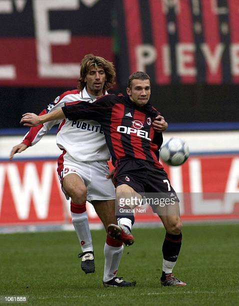Andriy Shevchenko of AC Milan and Roberto Maltagliati of Piacenza in action during the Serie A match between AC Milan and Piacenza played at the San...