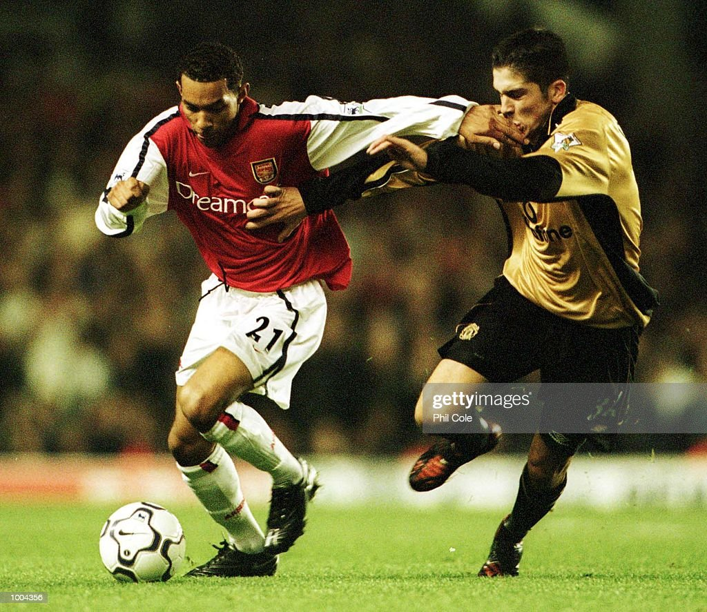 Bojan Djordjic of Manchester United tries to tackle Jermaine Pennant of Arsenal during the Worthington Cup, Third Round match between Arsenal and Manchester United at Highbury, London. Mandatory Credit: Phil Cole/ALLSPORT