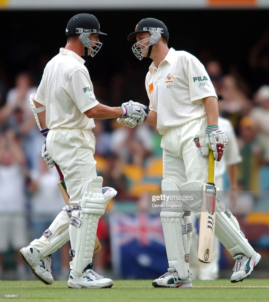 Brett Lee and Adam Gilchrist of Australia celebrate Lee scoring his 50 runs against New Zealand during day two of the first Cricket test between Australia and New Zealand played at the Gabba in Brisbane, Australia. DIGITAL IMAGE. MandatoryCredit: Darren England/ALLSPORT