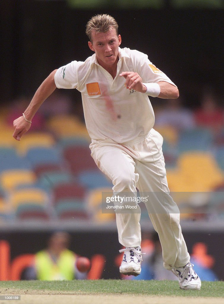 Brett Lee of Australia fields his own bowling during the fourth day of play in the first Test between Australia and New Zealand being played at the Gabba, Brisbane, Australia. DIGITAL IMAGE. Mandatory Credit: Jonathan Wood/ALLSPORT