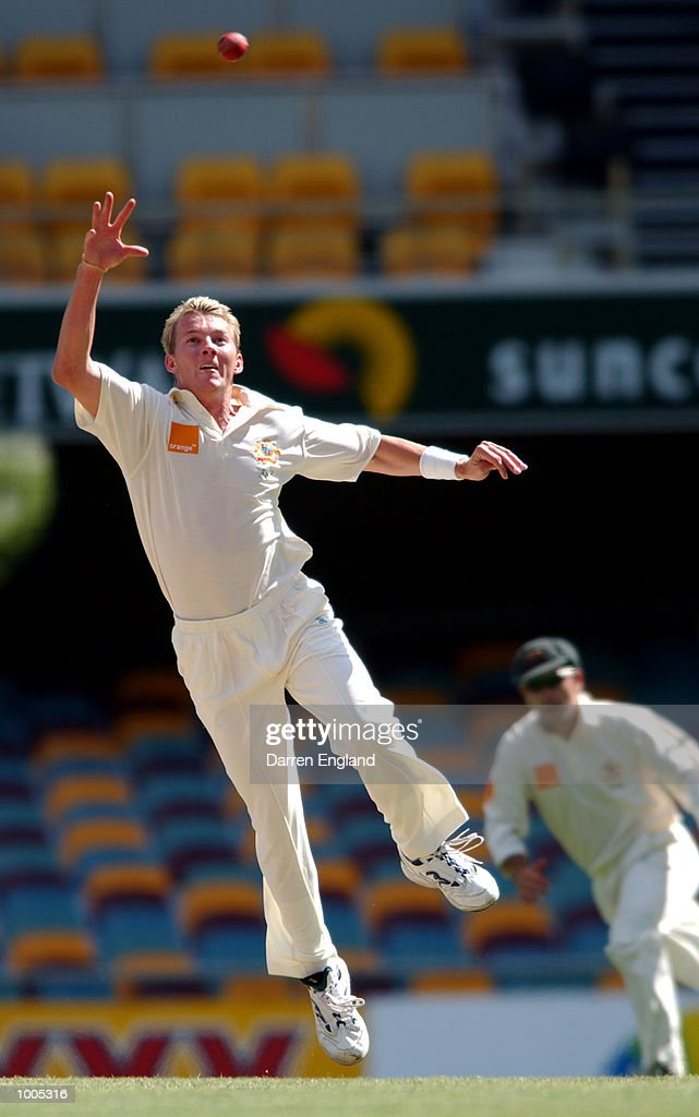 Brett Lee of Australia jumps up in attempt to stop four runs against New Zealand during day five of the first Cricket test between Australia and New Zealand played at the Gabba in Brisbane, Australia. DIGITAL IMAGE. Mandatory Credit: DarrenEngland/ALLSPORT